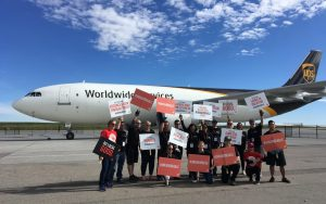 The OEL Projects Optimists team in front of plane